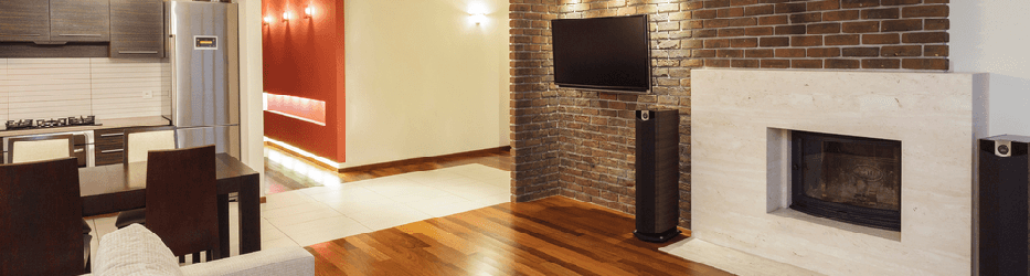 open concept brick entertainment and wood floors