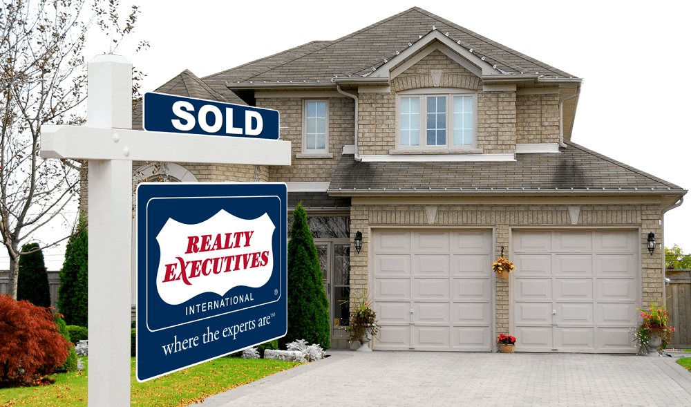 Realty Executives where the experts are SOLD property yard sign