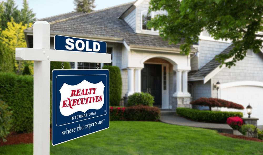 Realty Executives where the experts are yard sign SOLD